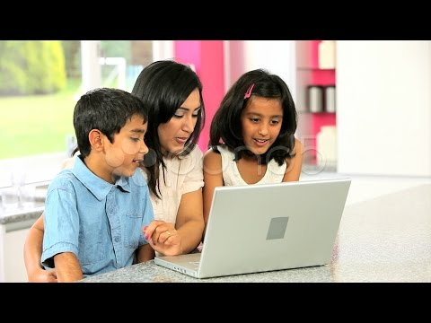 Attractive Asian Mother and Children Using Laptop. Stock Footage