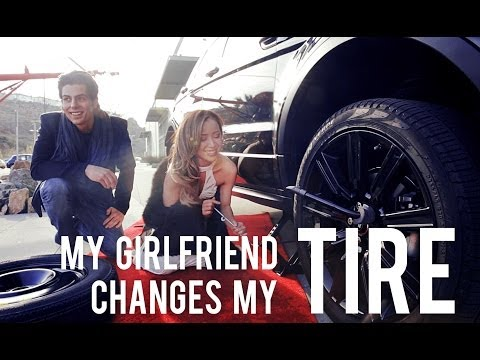 Girlfriend Changes Boyfriend's Tire