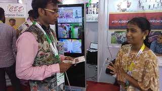 Training a girl student to explain about her event stall at IESA Events Expo Chennai Event Emcees