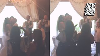 Wedding photographer violently pushes stepmom out of the shot