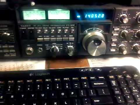 FT- 102 ham radio with computer showing weather