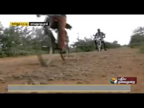 Road filled with potholes causes hardship to residents