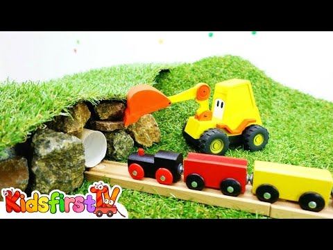 Excavator Max builds a tunnel for toy train.