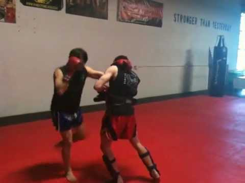 Nevada Muay Thai-Knees and Elbow drill on pads. Image 1