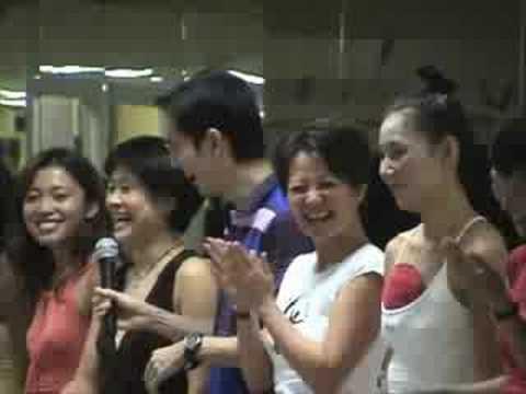"2007 Bikram Yoga Teacher Training Hawai'i. Talent show. ""Lock your Knee"" said in different languages"