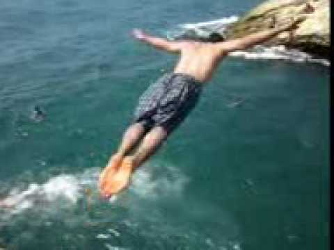 Jump into water in Beirut Lebanon Beach, cliff plunge in hot summer