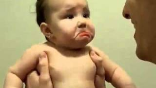 Cute baby laughs and cries at the same time.