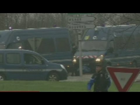 French police surround terror suspects near airport
