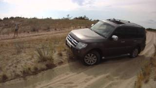 Pajero IV over small sand hill