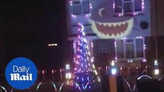 Family turn house into Baby Shark song Christmas lights display