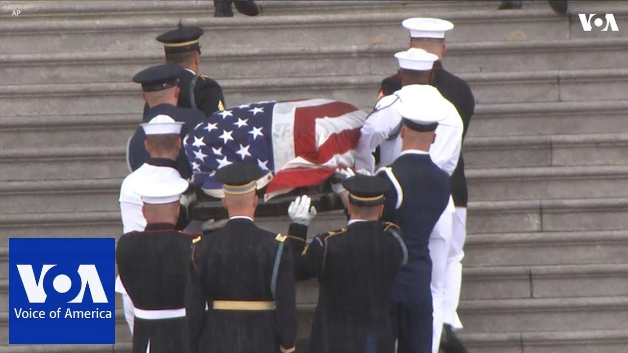 Sudden downpour of rain fell as Senator John McCain's casket escorted into Capitol