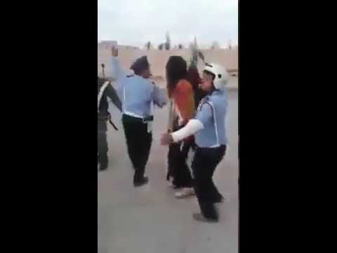 Moroccan Police, Gendarmes and Locals Dancing in the Streets During  Eid Al Adha Day thumbnail