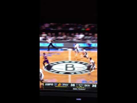 Markel Brown of Brooklyn Nets dunk on Phoenix Sun