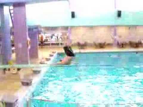 Fat guy falls off diving board