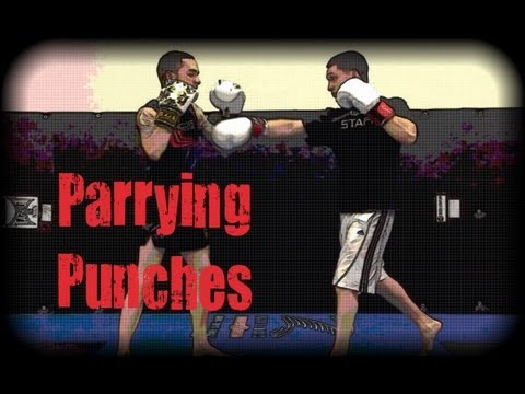 Muay Thai - How to Parry Punches Image 1