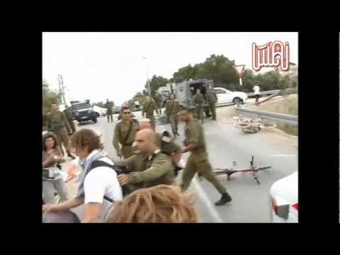 Israeli soldiers brutally attack Palestinians and ISM activists on bike ride