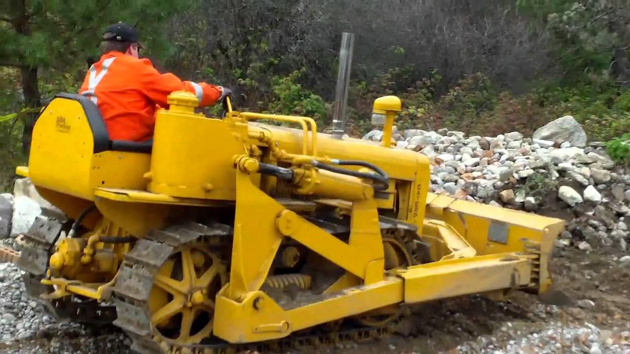 Old Bulldozer Loading Rocks Into Front End Loader Youtube
