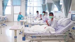 Rescued Thai boys wave from their hospital beds