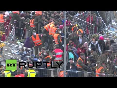 Austria: Scuffles break out as refugees push through border crossing at Spielfeld