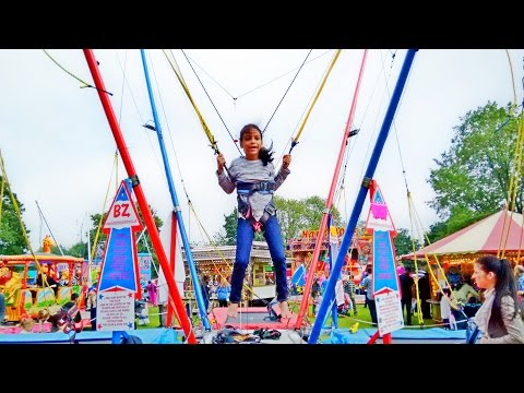 Kid Goes Bungee Jumping at The Carnival Fair  Fun Family Day Out  Nadia Amani Toys