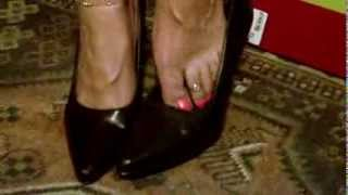 Mistress Mexi femdom shoeplay. Slowly puts long toenail latina feet into her heels.