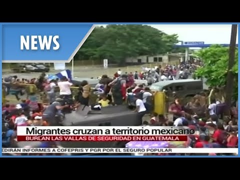 Migrant caravan bound for the US break through Mexico border