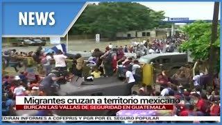 Migrant caravan bound for the US break through Mexico border