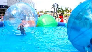 Giant WATER BALLS in a pool - Fun activities for Kids and Toddlers With Toys AndFun Sisters