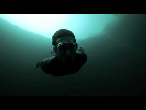 Guillaume Nery base jumping at Dean&#039;s Blue Hole, filmed on breath hold by Julie Gautier