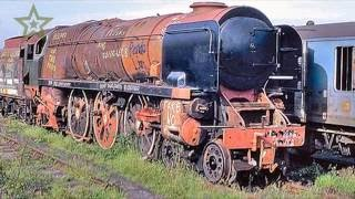 Old Abandoned Rusty Trains In UK. Abandoned Train Cars On The Barry Scrapyard. Ghost Train