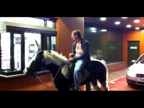 Drunken Man On Horse Goes Through McDonald