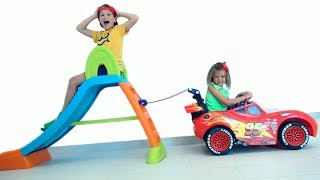 Katy and Max pretend play ride on cars and slide