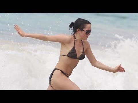 Doting Mum Andrea Corr Sizzles in a Black Bikini in Barbados - Splash News