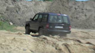 Jeep Cherokee XJ on the sand - HD