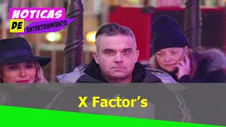 X Factor's Robbie Williams looks miserable as he takes wife Ayda Field on date to Winter