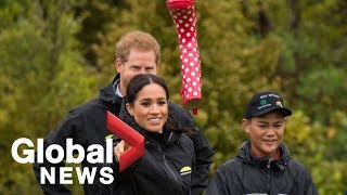 Meghan Markle beats Prince Harry to win 'gumboot' throwing contest in New Zealand