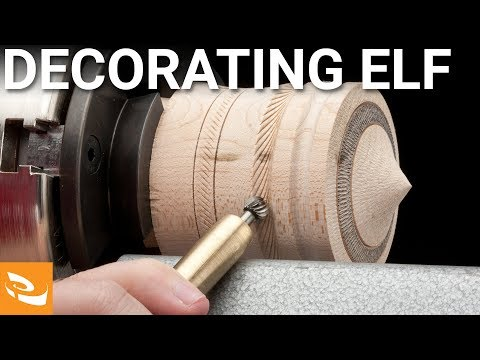 Decorating Elf by Henry Taylor