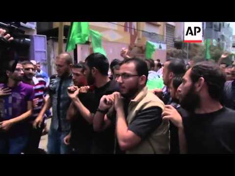 Hundreds of people attend funeral of Hamas fighter killed in Israeli airstrike