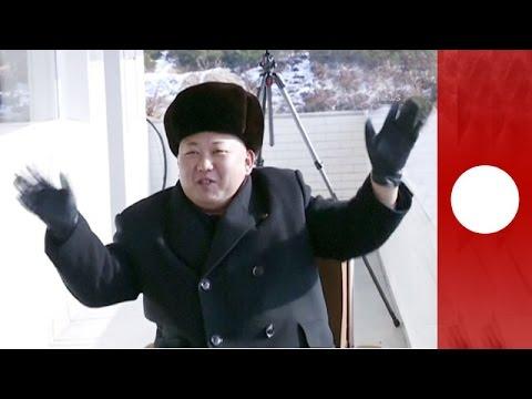 Kim Jong Un watches N.Korea military live-fire drills