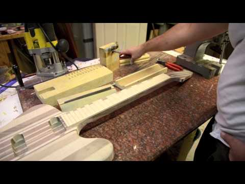 Firebird Fretboard - Luthier Fretting and build process with wood inlays birdseye maple fretwork