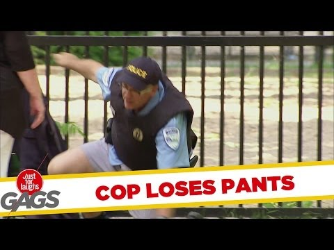 Cop Loses His Pants Climbing Over Fence - Rendőr a kerítésen