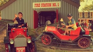 Riding the Old time Fire Trucks at Centreville Amusement Park