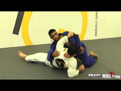 Learn another to escape side control with Marcelo Garcia Image 1