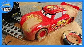 Disney Lightning McQueen car fell into a mud swamp. Rescue the McQueen car.
