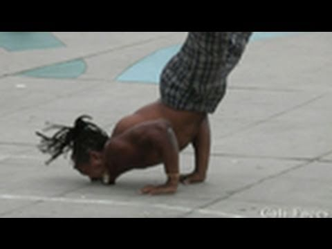 Guy Flips Over 7 People & Stands On His Face - Street Performers - Music Videos