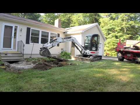 Mini Excavator Demolishing Concrete Walkway