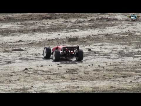 RC ADVENTURES - ELECTRIC Vs NITRO - LOSI 8T's HAVE A JUMP OFF - HEAD TO HEAD!