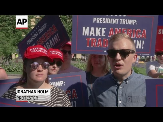Protesters Ready Messages for Trump, Putin