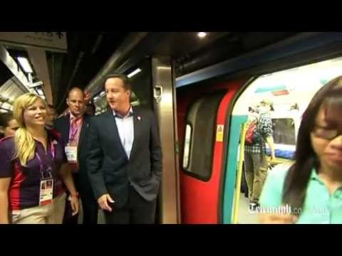 Prime Minister David Cameron rides London Underground to Olympic Park
