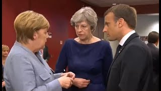 May, Macron & Merkel share hushed conversation in Brussels